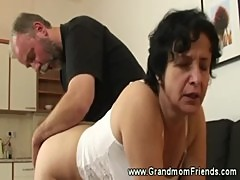 Blindfolded granny gets two cocks to suck