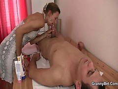 Granny masseuse jumps on young cock