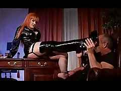 Latex Slut with Big Tits Gets Her Boots Licked