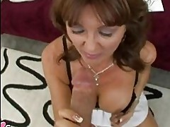 Steamy hot momma Desi Foxx munches a massive cock with pleas...