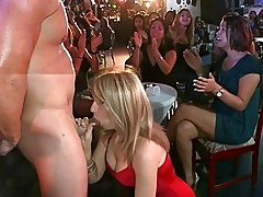 Clothed females watch naked men in massive stripper party