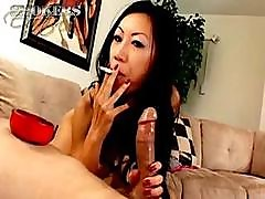 Tia Ling Likes To Suck On A Cigarette And A Hard Cock At Once
