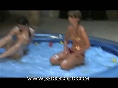 Topless teens playing in pool