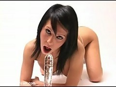Kream fucking both her holes with her long glass dildo